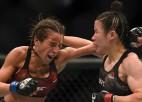 Ķīniete Džana fantastiskā dāmu cīņā pārspēj Jendžejčiku, UFC titulu nosargā arī Adesanja
