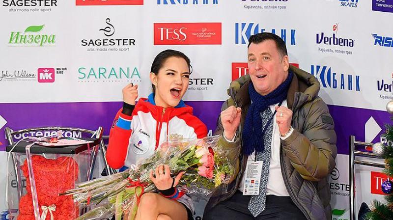Jevgēņija Medvedeva ar treneri. Foto: RIA Novosti