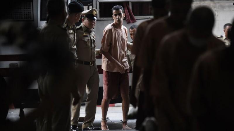 Hakīms Al-Araibi tiek atvests uz tiesas noklausīšanos Bangkokā. Foto: AFP/Scanpix