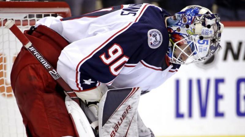 Elvis Merzļikins savā pirmajā NHL spēlē. Foto: AP/Scanpix